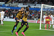 Joel Campbell of Arsenal celebrates with Santi Cazorla (l)after he scores his teams 3rd goal. Barclays Premier league match, Swansea city v Arsenal  at the Liberty Stadium in Swansea, South Wales  on Saturday 31st October 2015.<br /> pic by  Andrew Orchard, Andrew Orchard sports photography.