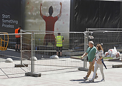 May 18, 2018 - Kiev, Ukraine - Ukrainians walk past a fence of a fan zone of the UEFA Champions League final in central Kiev, Ukraine, 18 May, 2018. The football UEFA Champions League final match between Real Madrid and Liverpool FC next May 26 at the NSC Olimpiyskiy Stadium. (Credit Image: © Str/NurPhoto via ZUMA Press)