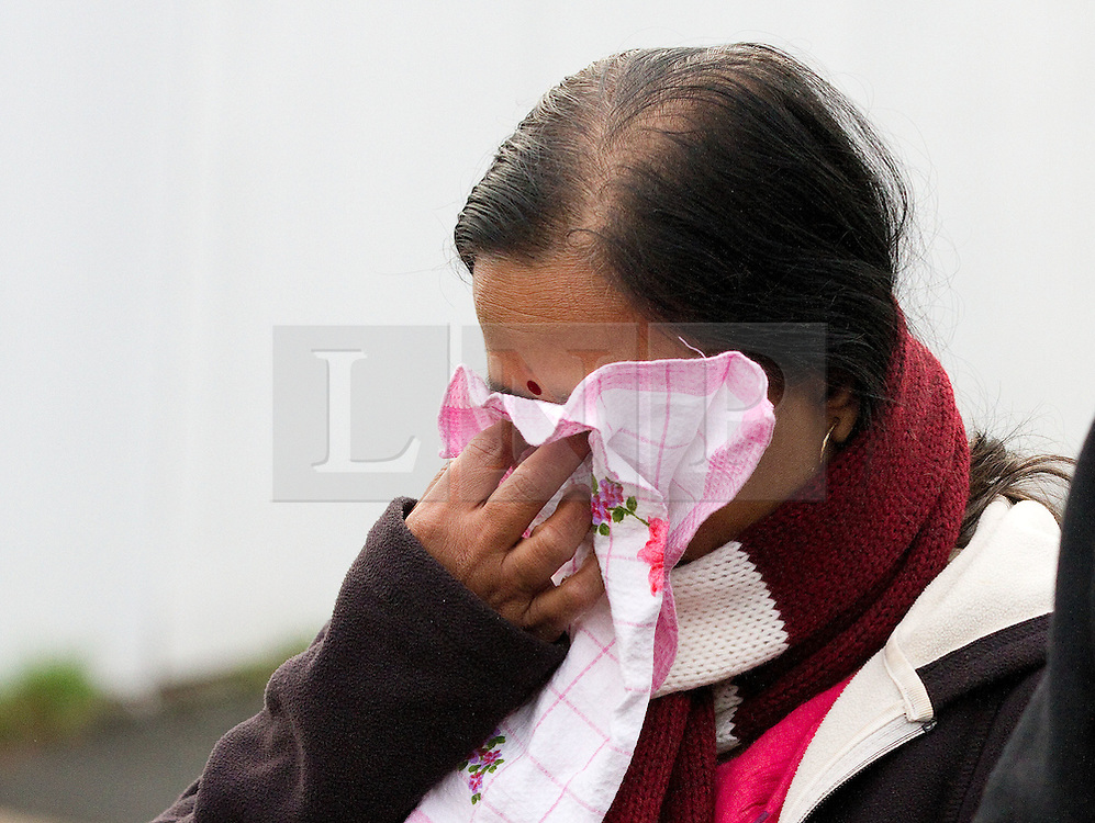 © Licensed to London News Pictures. 06/01/2012. Salford, UK. The mother of Anuj Bidve, who was murdered on Boxing Day in Salford, attends the scene of the crime, where a memorial shrine of flowers, candles and messages has been built. She cried as her husband read a prepared statement to the media. 20 year old Kiaran Stapleton of Regent Square, Ordsall, Salford, has been charged with Mr Bidve's murder. Photo credit : Joel Goodman/LNP
