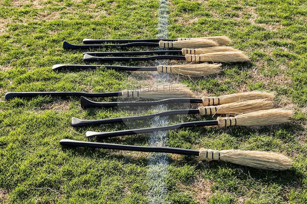 Broomsticks lined up and ready for play at the 7th Annual Quidditch World Cup April 5, 2014 in Myrtle Beach, South Carolina. The sport, created from the Harry Potter novels is a co-ed contact sport with elements from rugby, basketball, and dodgeball. A quidditch team is made up of seven athletes who play with broomsticks between their legs at all times.