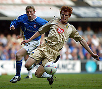 Photographer: Scott Heavey<br />Ipswich Town V Portsmouth. 18/04/03.<br />Hayden Foxe cuts out a cross to Alun Armstrong during this Nationwide Division one match at Portland Road.