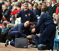 ARSENAL V MANCHESTER UNITED 03/04/04 VILLA PARK BIRMINGHAM FA CUP SEMI FINAL<br /> GARY LEWIN ARSENAL PHYSIO APPEARS TO BE STRUCK BY A MISSILE THROWN FROM THE CROWD<br /> PHOTO  FOTOSPORTS INTERNATIONAL