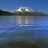 7,546-meter [Mount] Mustagh Ata reflects in Lake Karakul in the Pamir Mountains of Xinjiang Province in far western China.