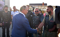 August 18, 2017 - Sevastopol, Crimea, Russia - Russian President Vladimir Putin greets members of the Night Wolves bike club Alexander Zaldostanov, left, at the Russian Reactor bike show August 18, 2017 in Sevastopol, Crimea, Russia. (Credit Image: © Alexei Druzhinin/Planet Pix via ZUMA Wire)