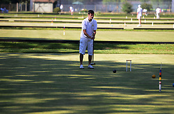 © Licensed to London News Pictures. 14/08/2013. Surbiton, UK Nick Mounfield, England in action. People participate in the14th World Association Croquet Championship at the Surbiton Croquet Club, Kingston upon Thames on the 14th August 2013. The Final will be played on Sunday 18th August. 80 competitors from 20 countries are taking part. Photo credit : Mike King/LNP