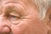 extreme close up of the face of an elderly man