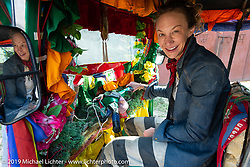 Danita Gayle checks out a tuk-tuk auto rickshaw on Motorcycle Sherpa's Ride to the Heavens motorcycle adventure in the Himalayas of Nepal. Riding from Chitwan to Daman. Tuesday, November 12, 2019. Photography ©2019 Michael Lichter.