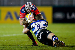 Bristol United Winger Ryan Edwards is tackled by Bath United Scrum-Half Jonathan Evans - Mandatory byline: Rogan Thomson/JMP - 28/12/2015 - RUGBY UNION - The Recreation Ground - Bath, England - Bath United v Bristol United - Aviva A League.