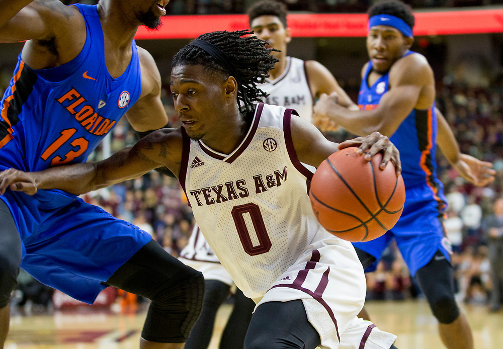 Texas A&M guard Jay Jay Chandler (0) drives the baseline against Florida forward Kevarrius Hayes (13) during the first half of an NCAA college basketball game Tuesday, Jan. 2, 2018, in College Station, Texas. (AP Photo/Sam Craft)