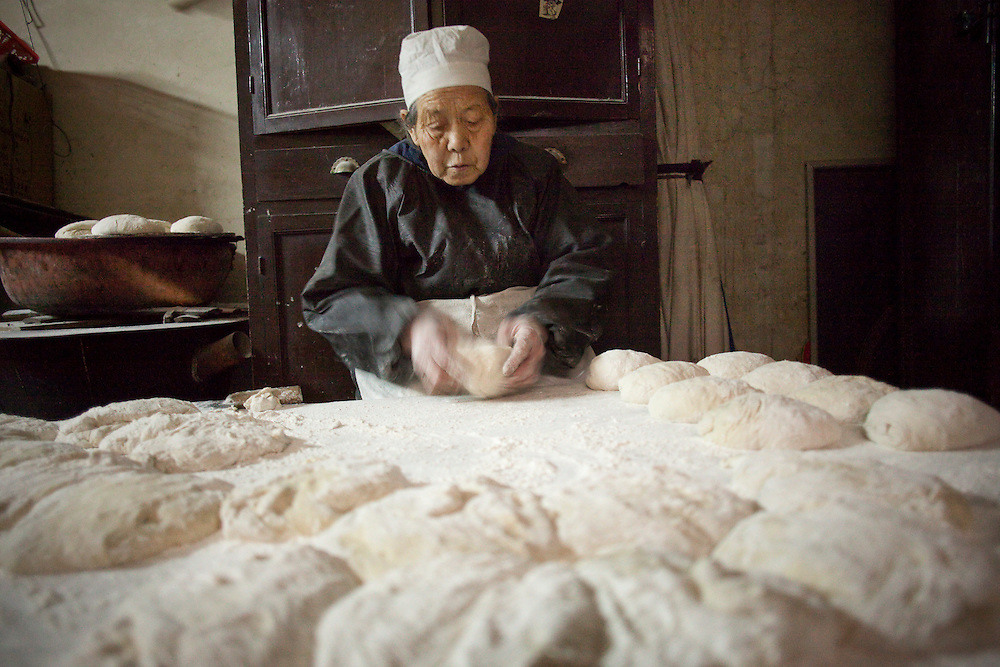 Women work early in the morning in the kitchen at the Wangjia Hutong Women's Mosque in Kaifeng, Henan province, China.