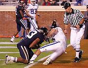 Virginia cornerback Chase Minnifield (13) makes a 4th quarter interception against Duke during an ACC football game Saturday in Charlottesville, VA. Duke won 28-17. Photo/Andrew Shurtleff
