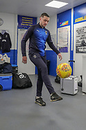 AFC Wimbledon midfielder Anthony Hartigan (8) kicking ball in changing room during the EFL Sky Bet League 1 match between AFC Wimbledon and Doncaster Rovers at the Cherry Red Records Stadium, Kingston, England on 9 March 2019.
