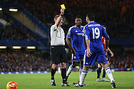 Referee Michael Jones gives a yellow card to Diego Costa of Chelsea for fouling Matt Ritchie of Bournemouth. Barclays Premier league match, Chelsea v AFC Bournemouth at Stamford Bridge in London on Saturday 5th December 2015.<br /> pic by John Patrick Fletcher, Andrew Orchard sports photography.