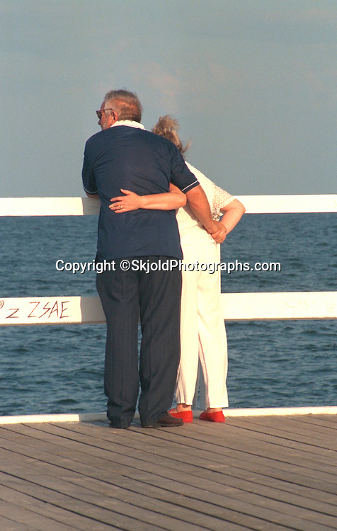 Couple age 60 embracing on dock overlooking the Baltic Sea.  Gdynia Poland