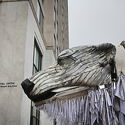 Aurora sniffs Shell's London HQ. The giant polar bear puppet Aurora made by Greenpeace walked the streets of London in defence of the Arctic as part of a Greenpeace global day of action. The parade,part performance part protest, was to highlight the melting ice caps and the increasing and potentially devastating oil drilling in the arctic sea. Shell is one of the companies drilling and the march through London ended up outside Shell London HQ to draw attention to their oil business in the arctic. Aurora, the biggest polar bear in the world represents all endangered species in arctic.