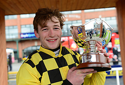 David Mullins poses with the trophy after winning The Ryanair Gold Cup Novice Chase on Al Boum Photo during Ryan Air Gold Cup Day of the 2018 Easter Festival at Fairyhouse Racecourse, Ratoath, Co. Meath.