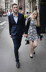 © Licensed to London News Pictures. 23/05/2017. London, UK. CONNIE YATES AND CHRIS GARD arre seen outside The Royal Courts of Justice in London where they are appealing an earlier court ruling that doctors can withdraw life-support treatment to their son, Charlie, who suffers from a rare genetic condition.  Doctors at Great Ormond Street Hospital in London say eight-month-old Charlie should be left to die in dignity, but his parents have raised over £1 million for specialist treatment in America. Photo credit: Peter Macdiarmid/LNP