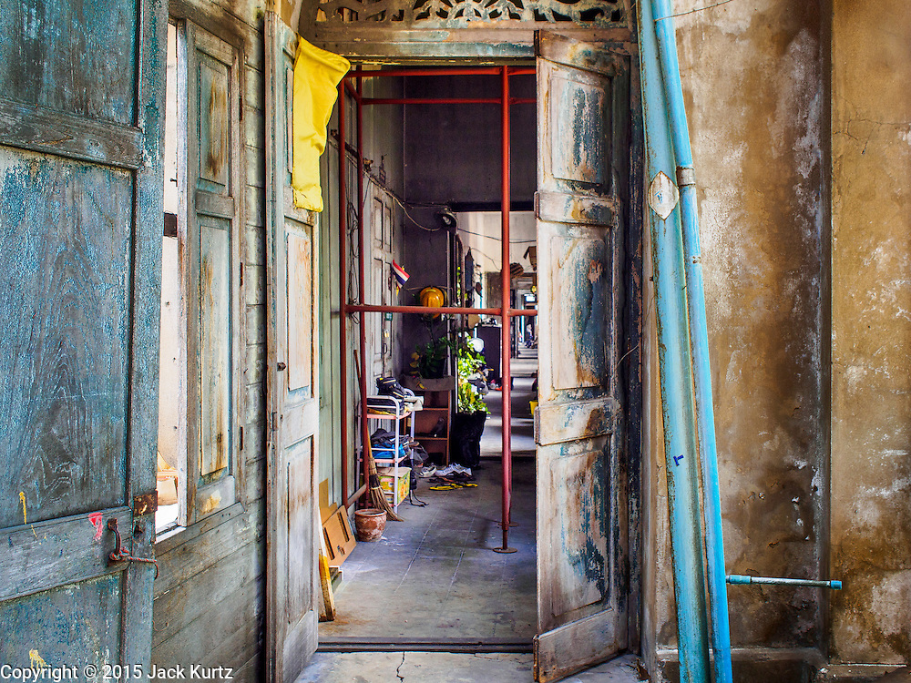 17 MARCH 2015 - BANGKOK, THAILAND: An interior hallways in the old Customs House in Bangkok. The old Customs House was once the financial gateway to Thailand (before 1932 called Siam). It was designed by an Italian architect in the 1880s. In the 1950s, customs moved to new, more modern building and the Customs House became the headquarters for the Marine firefighters. The firefighters now live in the decrepit buildings with their families.    PHOTO BY JACK KURTZ