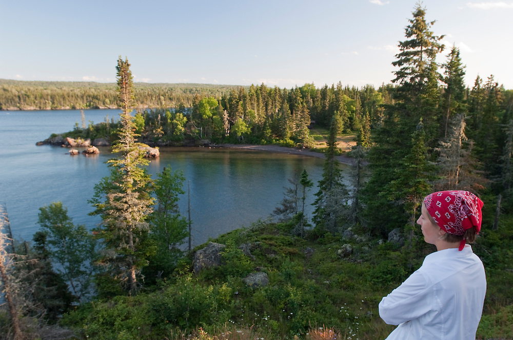 A hiker takes in the view from a hill at Isle Royale National Park.