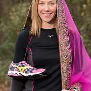"""Meghan Lyons poses for a portrait on Summer Rest Trail in Wilmington, N.C. wearing a Dupetta, a traditional Indian Wedding Veil. Lyons, who is running the Quintiles Wrightsville Beach Marathon for the 5th time on March 16th is also planning a traditional Hindu wedding for May 3rd. Running the marathon every year is a """"life goal"""" says Lyons who has ran the marathon every year since it was started. (Jason A. Frizzelle)"""
