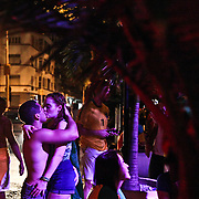 A Brazilian couple kisses after Brazil knocks Colombia out of the World Cup with a 2-1 victory in the quarter-finals match in Rio de Janeiro on Friday, July 4, 2014. Credit: Byron Smith
