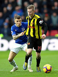 Everton's Lucas Digne (left) and Watford's Will Hughes (right) battle for the ball during the Premier League match at Vicarage Road, Watford.