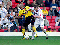 Photo: Leigh Quinnell.<br /> Watford v Hull City. Coca Cola Championship. 20/10/2007. Hulls Stephen McPhee tackles Watfords Jordan Stewart.
