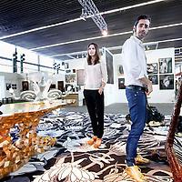Nederland, Amsterdam , 15 mei 2013.<br /> De KunstRAI begint woensdagavond in de RAI in Amsterdam. Op de 29e editie van de nationale kunstbeurs kunnen bezoekers kunst en design van ruim 75 bekende en opkomende galerieën aanschouwen en kopen.<br /> De KunstRAI wil bezoekers stimuleren echt aandacht te hebben voor kunst met een zogenoemde kunstdate. Geïnteresseerden kunnen aan een gedekt tafeltje een gerecht verorberen dat is geïnspireerd op een kunstwerk. Het is de bedoeling dat ze een kunstwerk beter leren kennen tijdens de eetafspraak.<br /> Naast een algemene stand hebben ongeveer 20 galerieën ook een speciale kraam waarin zij het werk van één kunstenaar exposeren.<br /> Op de foto: Kunstenaars Job en Nynke van Studio Job op hun stand tijdens de KunstRAI.<br /> Studio Job staat voor een kunst- en designcollectief, geleid door Job Smeets (1970) en zijn partner Nynke Tynagel(1977). De ontwerpers hebben een vestiging in Antwerpen.<br /> The art fair KunstRAI in the RAI in Amsterdam. On the 29th edition of the national art fair visitors can watch, admire and buy art and design of more than 75 known and emerging galleries.