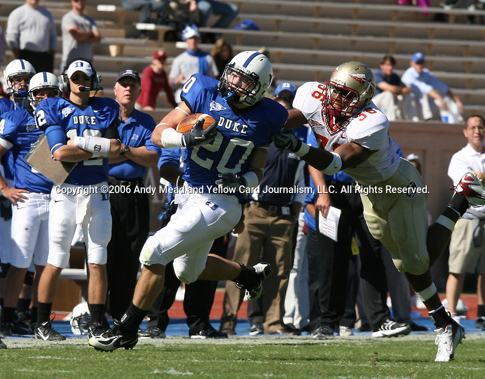 14 October 2006: Duke's Justin Boyle (20) is tackled by Florida State's Dekoda Watson (36). The Florida State University Seminoles defeated the Duke University Blue Devils 51-24 at Wallace Wade Stadium in Durham, North Carolina in an Atlantic Coast Conference NCAA Division I College Football game.