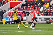 Brentford Forward Marcus Forss(#15) strikes the ball during the EFL Sky Bet Championship match between Brentford and Watford at Brentford Community Stadium, Brentford, England on 1 May 2021.