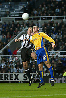 Photo: Andrew Unwin.<br />Newcastle United v Mansfield Town. The FA Cup.<br />07/01/2006.<br />Newcastle's Alan Shearer (L) competes with Mansfield's Jake Buxton (R).