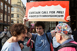 London, UK. 30th March, 2019. A member of the public contests activists from London Palestine Action protesting outside the Gielgud Theatre where Mel Giedroyc is appearing in the musical Company to call on her to withdraw from hosting Eurovision 2019 in Tel Aviv in recognition of the Palestinian call for a cultural boycott of Israel and in order not to assist with the 'culturewashing' of Israeli human rights abuses.