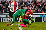 Woking goalkeeper Craig Ross (1) tangles with Watford midfielder Nathaniel Chalobah (14) during the The FA Cup 3rd round match between Woking and Watford at the Kingfield Stadium, Woking, United Kingdom on 6 January 2019.