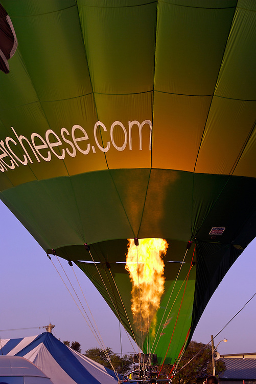 Burners directing flames into the envelope at the 25th Annual Sunrise Community Hot Air Balloon Event. Sunrise Coomunity is a non profit service provider of programs that supports people with living mental and physical challenges.