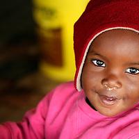 Africa, Namibia, Windhoek. A young Namibian baby at the Katutura street market.