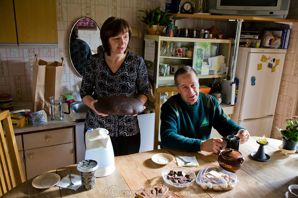 Aivars  Radzins, a forester and beekeeper, with his wife at their home in Vecpiebalga, Latvia. (Aivars Radzins is featured in the book What I Eat: Around the World in 80 Diets.) MODEL RELEASED.