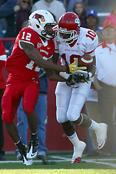15 October 2011: Marquis Butler gets the interception on a ball intened for Tyrone Walker during an NCAA football game between the University of South Dakota Coyotes and the Illinois State Redbirds (ISU) at Hancock Stadium in Normal Illinois.