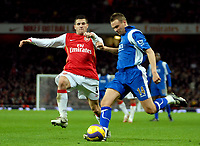 Photo: Ed Godden.<br /> Arsenal v Portsmouth. The Barclays Premiership. 16/12/2006. Portsmouth's Matthew Taylor crosses the ball ahead of Cesc Fabregas (L).
