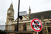 March against austerity, London June 20th 2015. A sign saying 'No cuts' is placed in front of Big Ben and the Houses of Parliament.