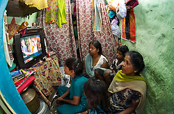 Pant Nagar, New Delhi, India  29/04/2011. The Royal Wedding of HRH Prince William to Kate Middleton. Residents of Pant Nagar a small colony in South Delhi watch the marriage on TV of Britain's Prince William with his fiancee Catherine Middleton at London's Westminster Abbey..Photo credit should read: LNP. Please see special instructions. © under license to London News Pictures