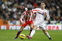 01.12.2012 SPAIN -  La Liga 12/13 Matchday 14th  match played between Real Madrid CF vs  Atletico de Madrid (2-0) at Santiago Bernabeu stadium. The picture show Juan Francisco Torres (Spanish midfielder of At. Madrid) and  Cristiano Ronaldo (Portuguese forward of Real Madrid)