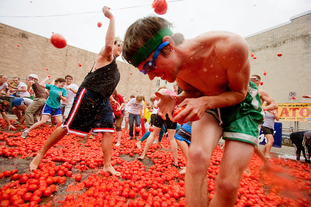 Over 200 participated in Milwaukee's 4th annual Tomato Romp on North Avenue, Saturday, Sept. 18, 2010. A $3 donation was required as well as the use of safety glasses. Proceeds from the the fight went to Feeding America. The fight was the last event in the festival which included The East Side Green Market and a bloody mary competition and tasting.