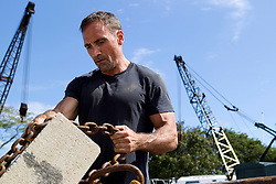 man working at a junk yard