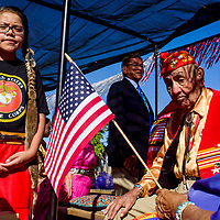 Code Talker George Willie rides with his wife Emma J. Willie and great granddaughter Ashley Lee on a float in the Navajo Code Talker Day parade in Window Rock Monday.