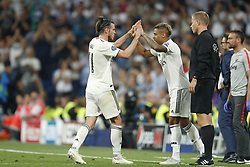 (L-R) Gareth Bale of Real Madrid, Mariano Diaz of Real Madrid during the UEFA Champions League group G match between Real Madrid and AS Roma at the Santiago Bernabeu stadium on September 19, 2018 in Madrid, Spain