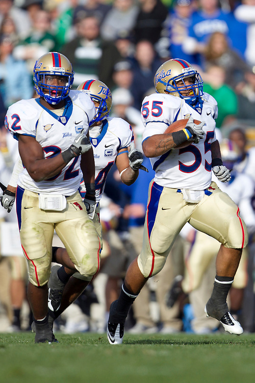 Tulsa linebacker Shawn Jackson (#55) runs for yardage after he intercepted pass during NCAA football game between Tulsa and Notre Dame.  The Tulsa Golden Hurricane defeated the Notre Dame Fighting Irish 28-27 in game at Notre Dame Stadium in South Bend, Indiana.