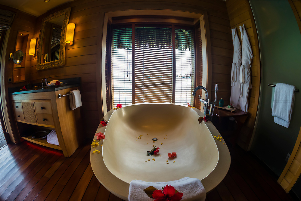 Interior view of Overwater bungalow suite with plunge pool, Four Seasons Resort Bora Bora, French Polynesia.