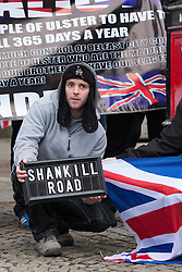 """© Licensed to London News Pictures . 19/01/2013 . Manchester , UK . A man holds a """" Shankill Road """" sign . Loyalist protesters demonstrate outside Manchester Town Hall in the city's Albert Square , today (19th January 2013) . Photo credit : Joel Goodman/LNP"""