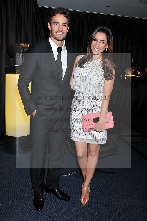KELLY BROOK and THOM EVANS at the GQ Men of The Year Awards 2012 held at The Royal Opera House, London on 4th September 2012.
