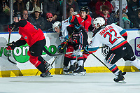KELOWNA, BC - DECEMBER 30:  Pavel Novak #11 of the Kelowna Rockets is checked by Josh Maser #11 of the Prince George Cougars during second period at Prospera Place on December 30, 2019 in Kelowna, Canada. (Photo by Marissa Baecker/Shoot the Breeze)